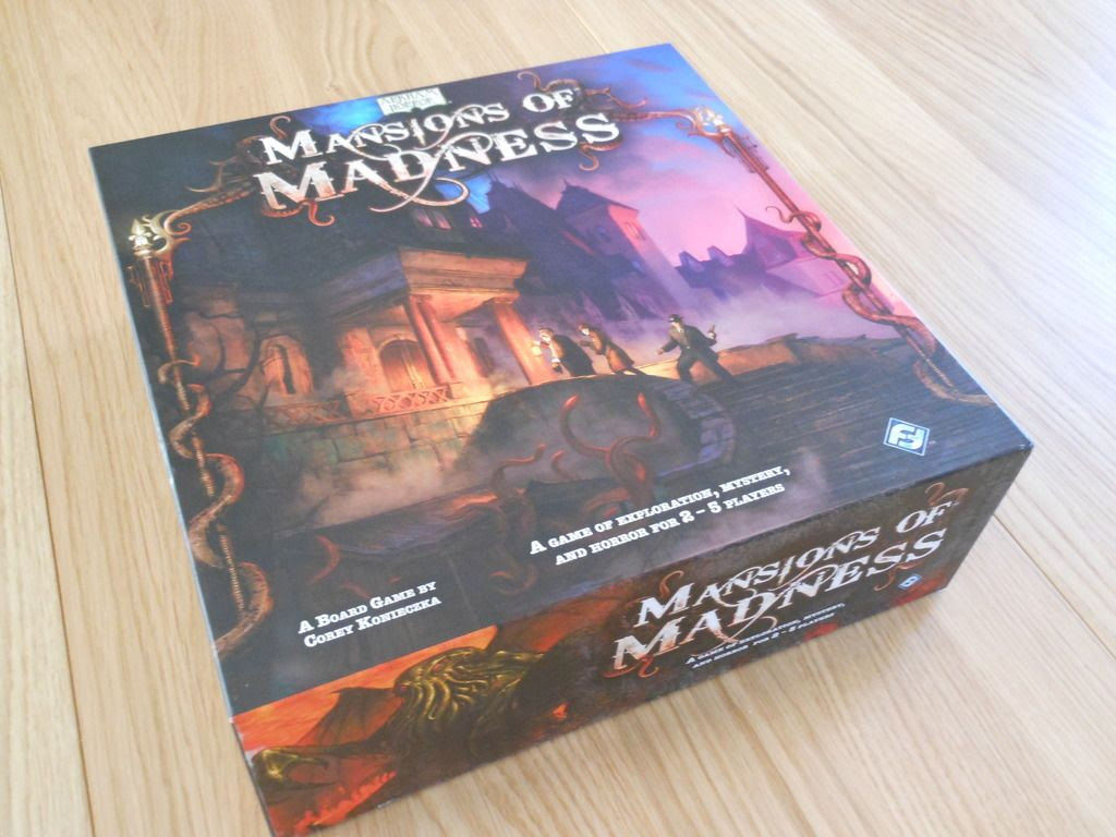 View of the Mansions of Madness board game box, with artwork depicting nervous investigators entering a mysterious building.