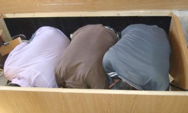 Stuffed tight: Mexicans crouch in a box after being discovered