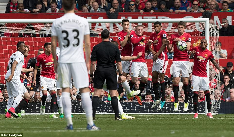 But Gylfi Sigurdsson cancelled Rooney's effort out with a sweet, curling free kick to level the game at 1-1