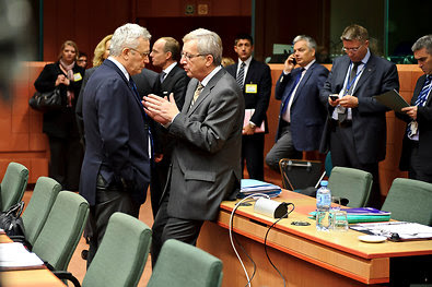 Giulio Tremonti, Italy's finance minister, left, and Jean-Claude Juncker, the Eurogroup head. Rates on Italy's debt have risen.