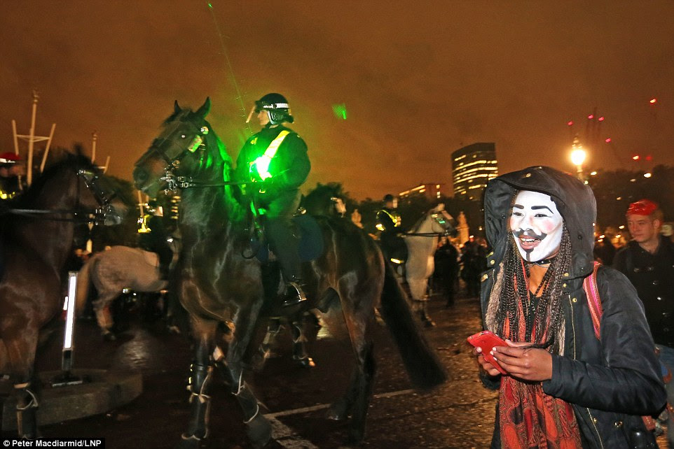 Demonstrators used lasers to spook mounted police officers who were on hand to keep the peace outside Buckingham Palace