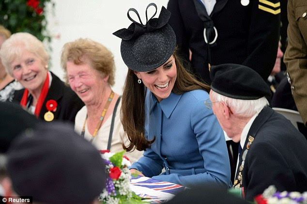 Warm: The Duchess of Cambridge beams as she chats to a veteran at a tea party in Arromanches