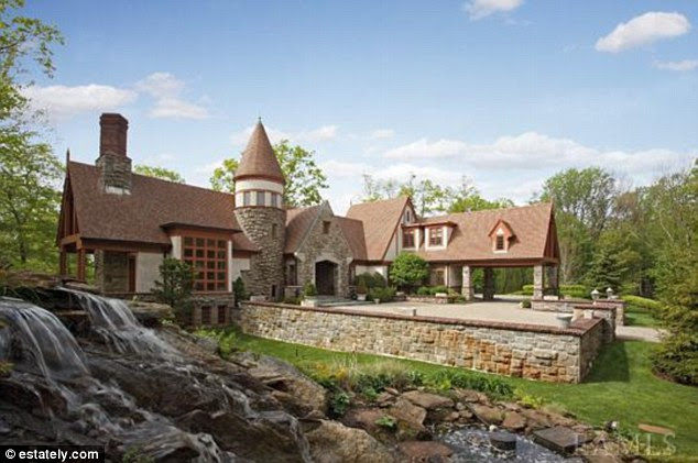 Wooded: This five-bedroom 2001-built home in Armonk, New York is listed for $3,999,999