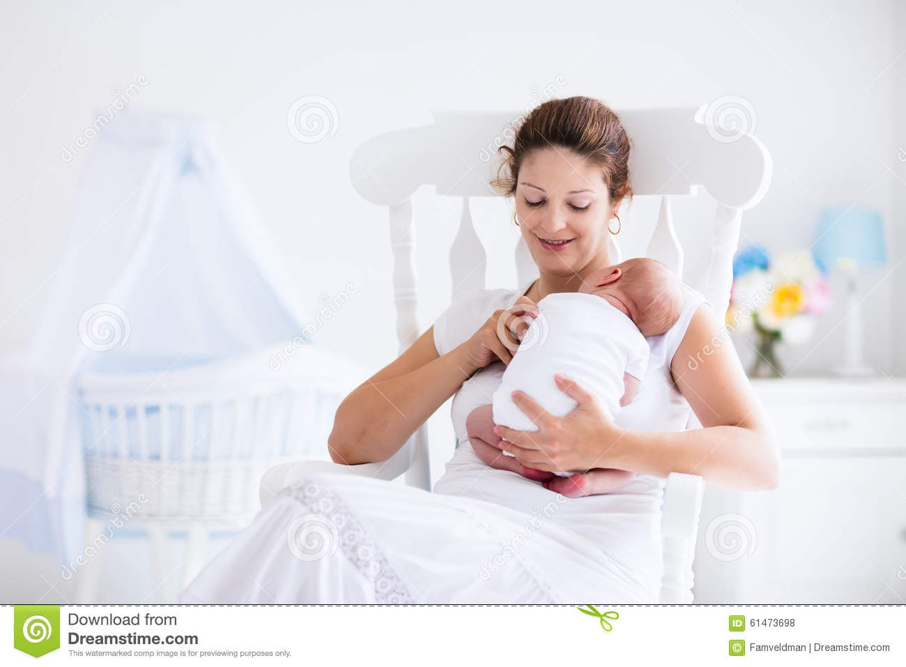 mother newborn baby white nursery young holding her child mom nursing woman new born boy relax bedroom rocking chair 61473698