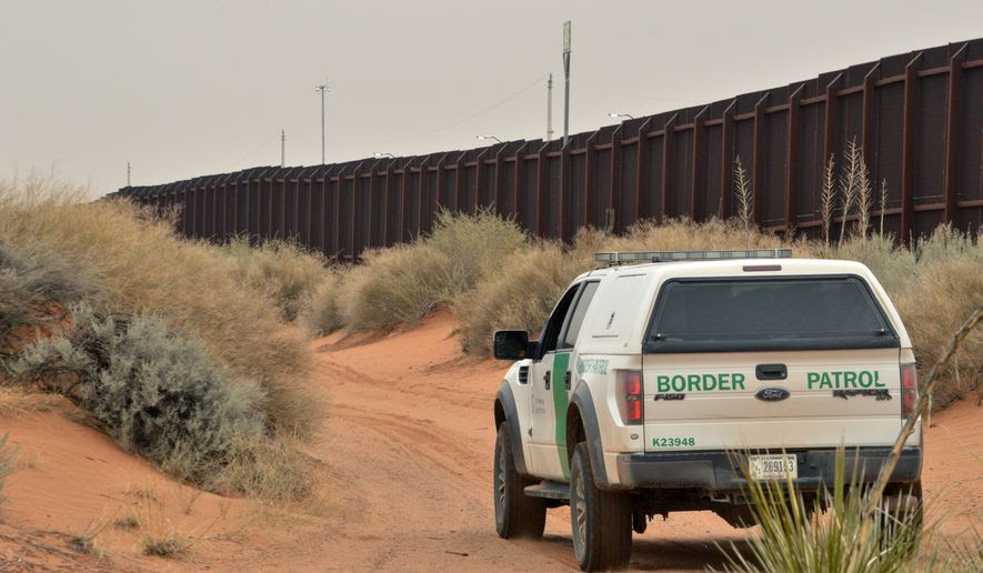 A U.S. Border Patrol agent drives near the U.S.-Mexico border fence in Santa Teresa, N.M. (Associated Press)