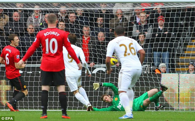 Super Spaniard: Michu (9) taps home Swansea's equaliser following Jonathan De Guzman's effort