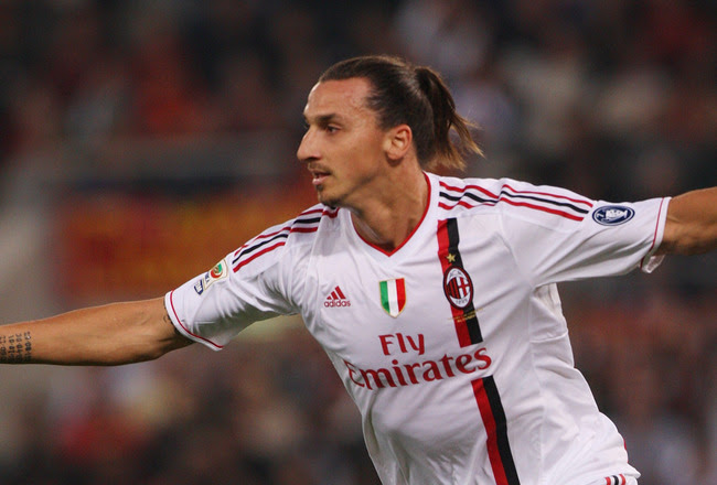 ROME, ITALY - OCTOBER 29: Zlatan Ibrahimovic of AC Milan celebrates after scoring the opening goal during the Serie A match between AS Roma and AC Milan at Stadio Olimpico on October 29, 2011 in Rome, Italy. (Photo by Paolo Bruno/Getty Images)
