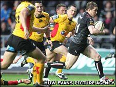 Shane Williams makes a break for the Ospreys