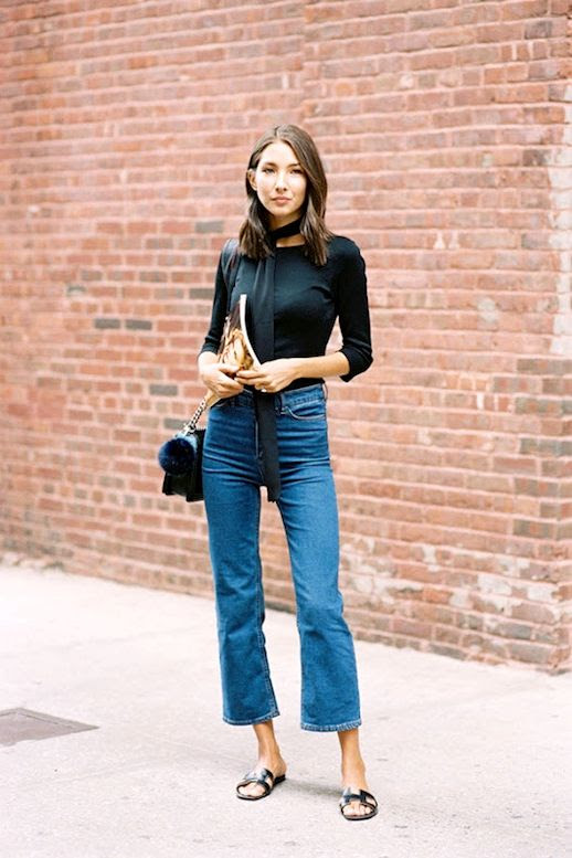 Le Fashion Blog Street Style Black Long Skinny Scarf Quarter Sleeve Tee Shirt Quilted Purse With Fur Pom Pom Keychain Kick Flare Jeans Hermes Slide Sandals Via Vanessa Jackman