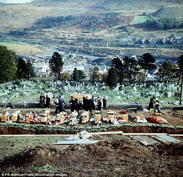 Coffins arriving at the cemetery during the funeral of 82 victims - 81 of them children - of the Aberfan coal tip disaster. The victims died when a mass of coal slurry flooded the local school