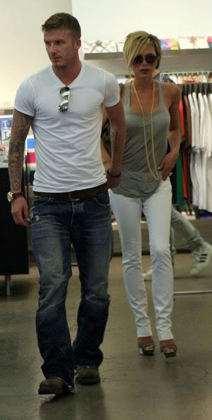 David Beckham and Victoria Beckham wearing dVb jeans