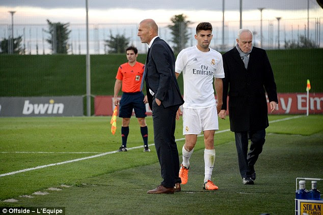 Like Guardiola, Zidane, pictured with son Enzo (centre), has earned his coaching experience in the youth set up