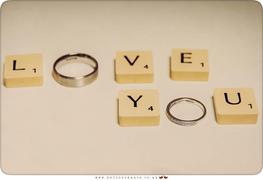 Scrabble tiles and wedding rings bands at Maison Talbooth Dedham Wedding Photography Essex - Sian and James - Hello Romance Wedding Photography