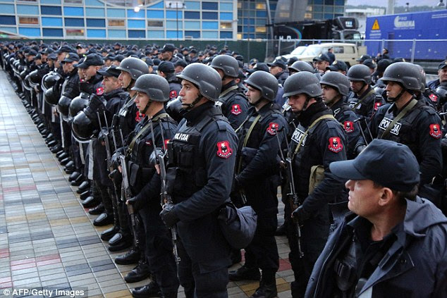 Albanian special policemen take part in a security briefing at the Elbasan Arena stadium before the World Cup group match