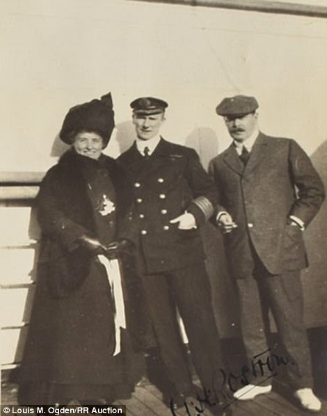 The Ogdens are pictured above with the captain of the Carpathia