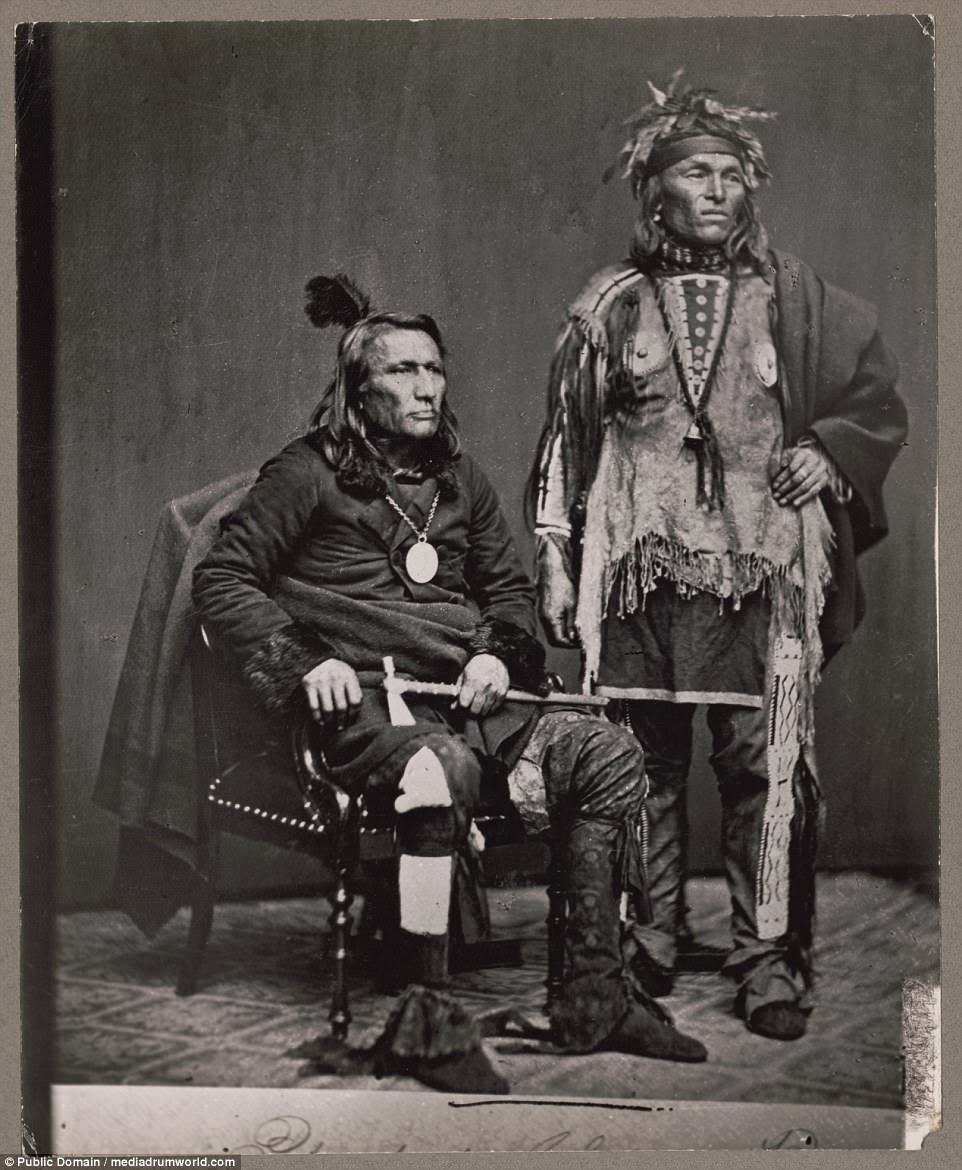 Chief Crane of the Potawatomi, holding tomahawk and with unidentified Native American man in a delegation to Washington, D.C, in 1860