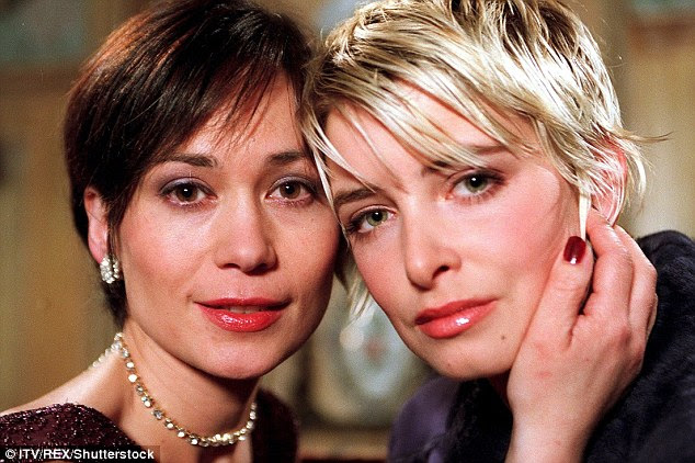 Leah as Zoe Tate with Charity Dingle, played by Emma Atkins, in a 2001 episode of Emmerdale