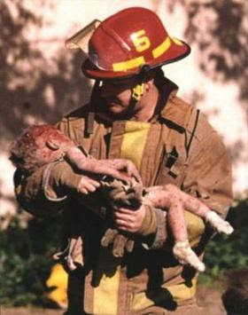 firefighter carrying the dying baby