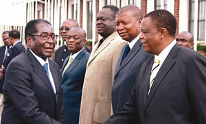 President Mugabe being welcomed home by services chiefs — (from right) Commander of the Zimbabwe Defence Forces General Constantine Chiwenga, Major General Trust Mugoba, Air Marshal Perrance Shiri and ZRP Commissioner General Augustine Chihuri. by Pan-African News Wire File Photos