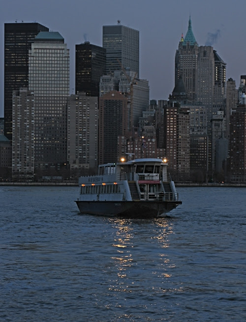 a NY WATERWAY ferry on the Hudson River at dusk, NYC