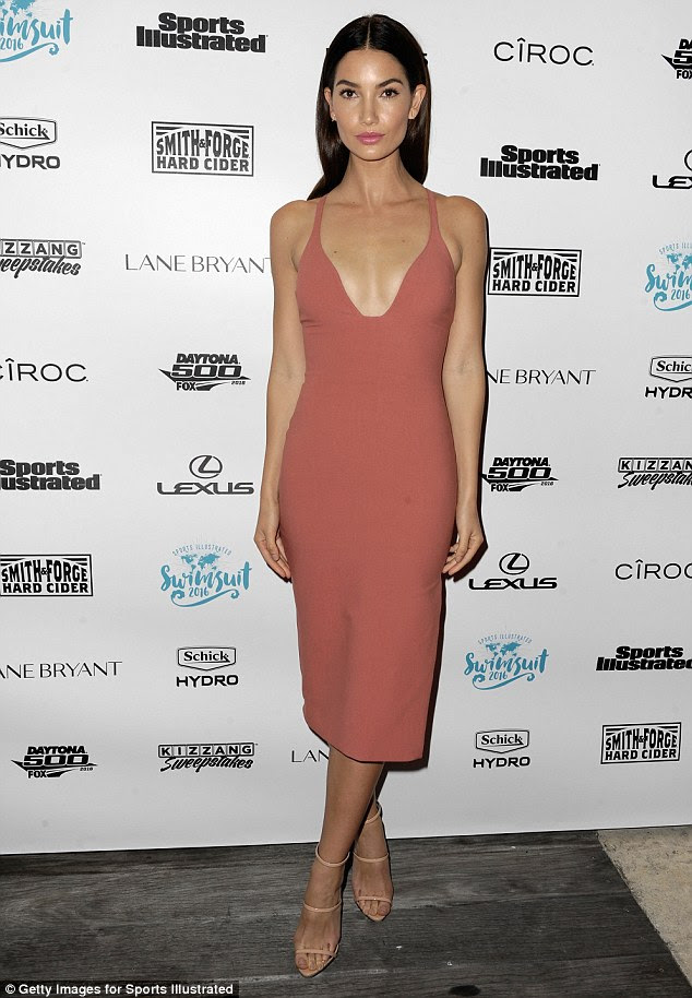 How low can you go: Lily, 30, drew all eyes to her ample assets as she picked out a plunging slip dress for the event