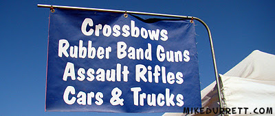Sign: Crossbows, Rubber Band Guns, Assault Rifles, Cars & Trucks