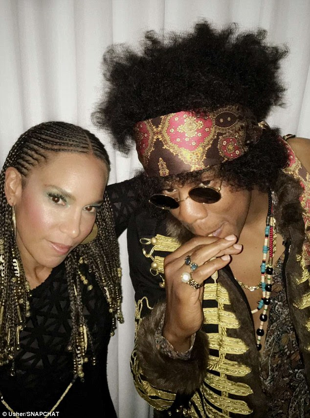 Old school! Queen Bey's 45-year-old husband of eight years resembled guitar god Jimi Hendrix as he puffed on a suspicious-looking cigarette alongside Usher's second wife Grace