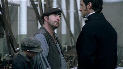 Little Tom, Higgins and Thornton exchanging words in the mill.