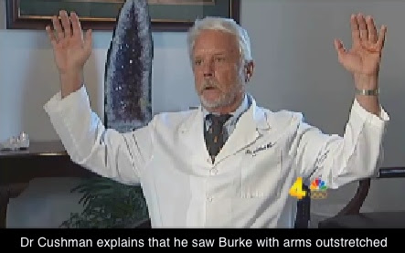 Dr Cushman, arms raised