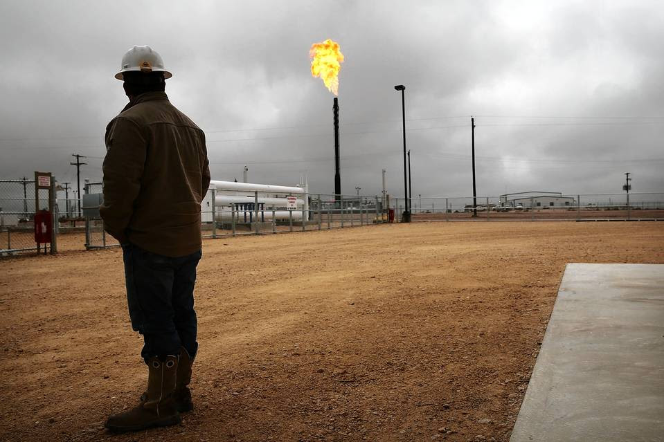 Flared natural gas is burned off at a plant in the Permian Basin in Garden City, Texas, in February.