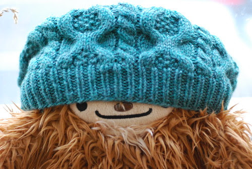 Quatchi models the hat