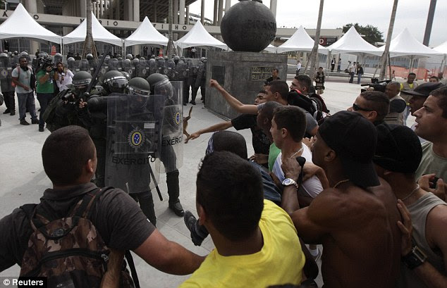 Thorough: Also in Rio, Army officers take part in an exercise outside the Maracana Stadium