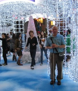 Gil at the mall in front of the lighted display