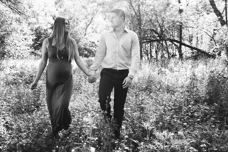 A late spring maternity photo session with a stunning mother-to-be in a beautiful outdoor location surrounded by gravel trails, a covered bridge, and large apple tree. We ended the session with Kacia standing in a shallow creek.