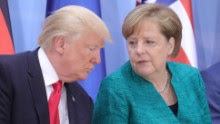 """German Chancellor Angela Merkel (R) and US President Donald Trump attend a panel discussion titled """"Launch Event Women's Entrepreneur Finance Initiative"""" during the G20 summit in Hamburg, northern Germany, on July 8, 2017. Leaders of the world's top economies gather from July 7 to 8, 2017 in Germany for likely the stormiest G20 summit in years, with disagreements ranging from wars to climate change and global trade. / AFP PHOTO / POOL / Michael Kappeler        (Photo credit should read MICHAEL KAPPELER/AFP/Getty Images)"""