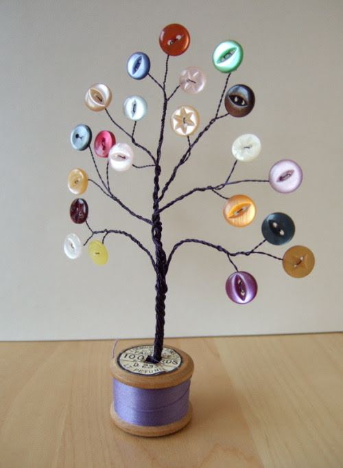 truebluemeandyou:  DIY Inspiration - Button Tree. This is pretty cool and you know I post a lot of button crafts (and recently wire crafts) on my blog. From The Kitsch and the Curious here.  I would turn this into an earring holder. Put the post earrings through the button holes? Or have felt leaves to poke posts through.