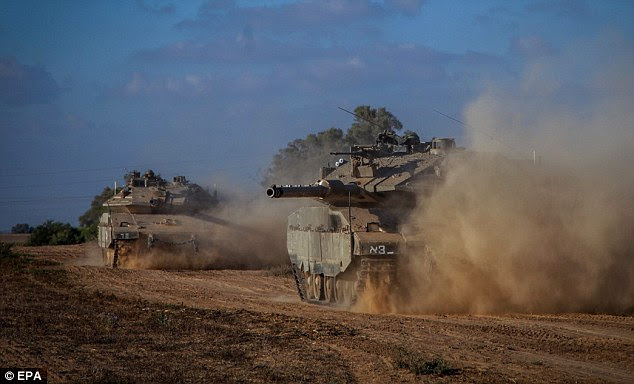 Forces mass: Israeli Markava tanks heading toward the Israeli Gaza border, 18 July 2014. The Israeli military launched a ground operation overnight in the Gaza Strip, following the failure of ceasefire efforts after a 10-day air campaign