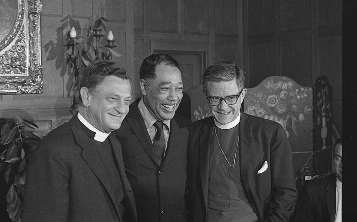 Duke Ellington (center)  and Reverend C. Julian Bartlett (left) and Bishop James Pike (right) meet to announce that Duke Ellington will compose a piece and perform a sacred music concert to celebrate the opening of Grace Cathedral photos shot 08/26/1965