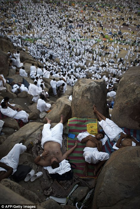 Many of the exhausted pilgrims slept at the foot of Mount Arafat after walking the nine miles from Mecca with thousands of others (pictured)