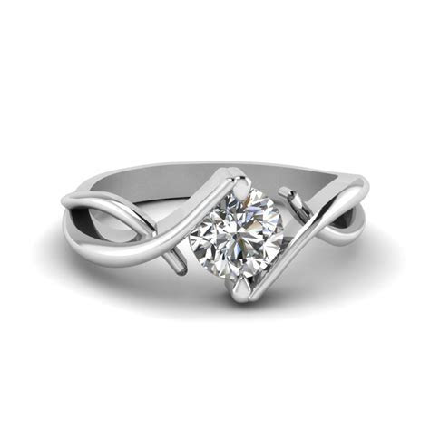 Beautiful Twist Single Diamond Engagement Ring In 14K