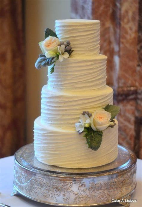 Simple 2 tier cake with rippled white icing and 2