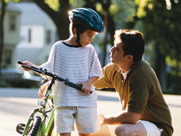 Kid on Bike with Dad