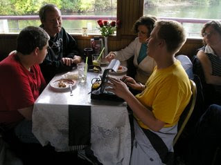 guests on the Willamette Queen enjoy some snacks while learning about BrailleNote GPS