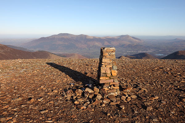04D-2228 The Summit Trig Point on Crag Hill and the View NE Over the Mountains of Skiddaw and Blencathra Lake District Cumbria UK