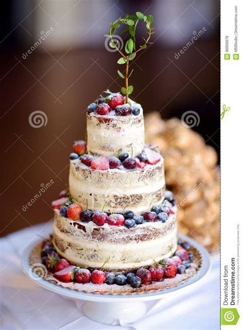 Delicious Chocolate Wedding Cake Decorated With Fruits And