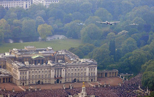 A Spitfire, Hurricane and Lancaster from the Royal Air Force Battle of Britain Memorial Flight fly over Buckingham Palace as William and Kate emerge on the balcony