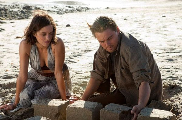 Cobb shares a moment with his late wife Mal (Marion Cotillard) within a dream world in INCEPTION.