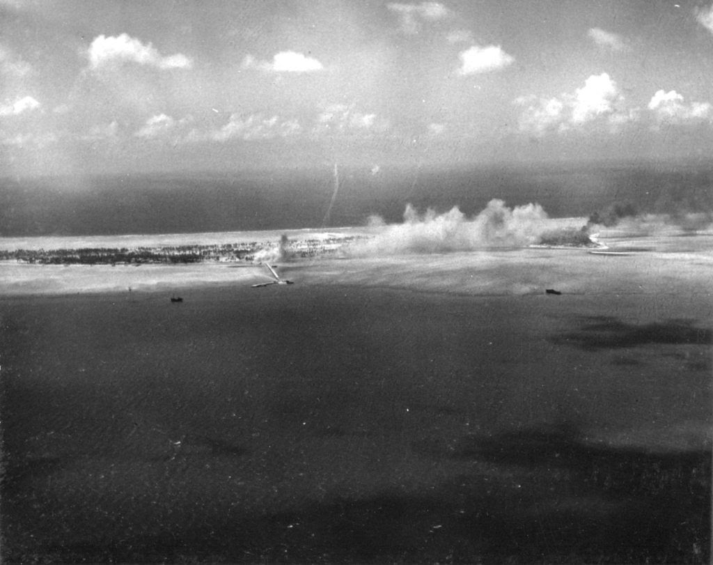 Bititu (Betio) under attack. The Pier area is in the foreground. (US Navy photo: Scanned by John G. Lambert)