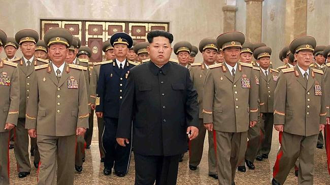 Kim Jong-un looking serious. This must have been before he found out he beat his father's
