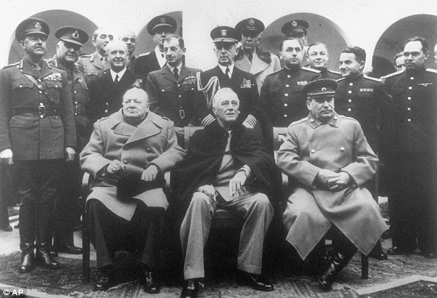 Talks: Winston Churchill (left) was said to have been swayed against the idea for summary executions at the Yalta 'Big Three' conference in 1945 by US president Franklin D Roosevelt (centre) and Joseph Stalin (right)